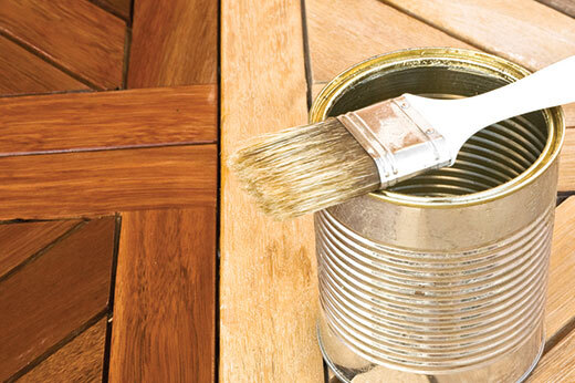 Deck stain with paintbrush